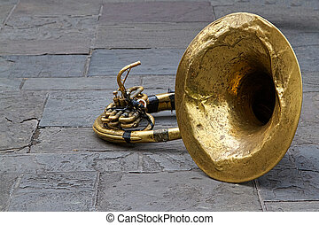 A well used tuba lies on the ground in Jackson Square, New Orleans