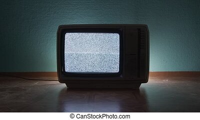 Old TV agains green background closeup photo