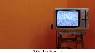 Vintage TV set on a chair in an empty room, panning slider camera move