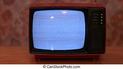 Vintage TV set with no reception noise on screen. Black and white television.