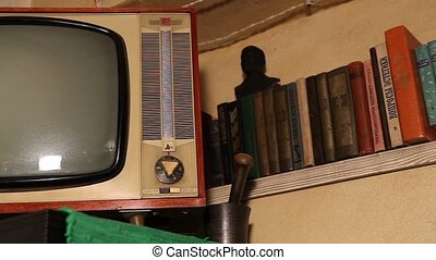 Old TV, retro TV in an old interior. Authentic Old TV