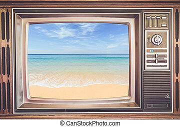 Old TV with tropical sea on screen