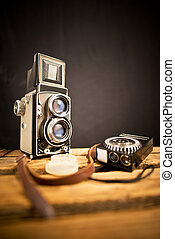 old twin-lens reflex camera with light meter on the black ...