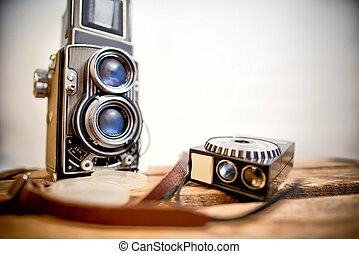 old twin-lens reflex camera with light meter on the white ...