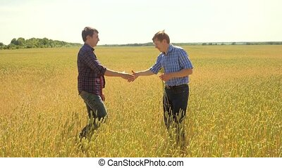 old two farmers explore are studying handshake . man Wheat...