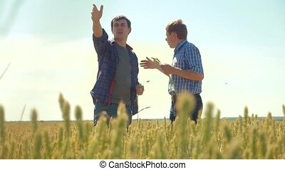 old two farmers summer handshake man Wheat Field running in...