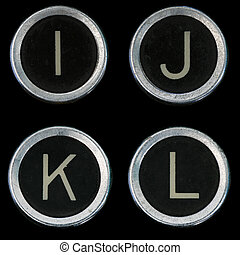 I J K L keys from old typewriter on black background
