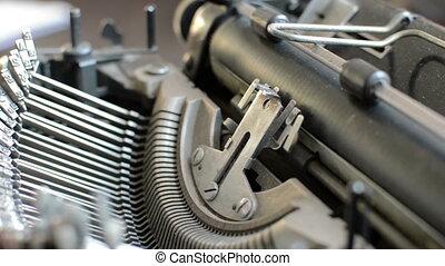 Old typewriter machine detail, typing  on vintage typing machine.