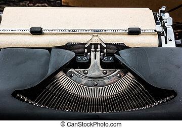 Old typewriter on table.