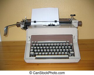 Old typewriter with blank letter