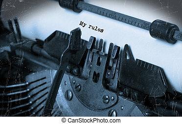 Old typewriter with paper - Close-up of an old typewriter...