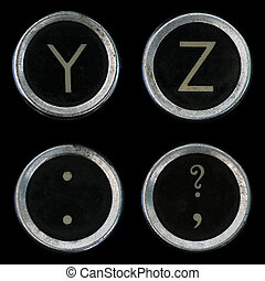 Y Z and question mark comma and period keys from old typewriter on black background