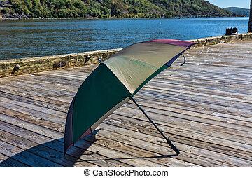 Old umbrella forgotten on the dock