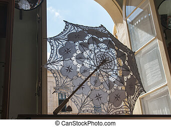 old umbrella in window