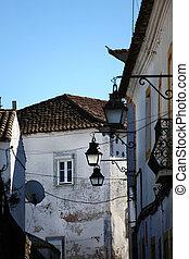Old urban street in Evora town. Alentejo, Portugal, Europe.