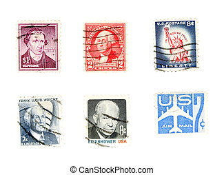 Cancelled postage stamps with heads of presidents. US collectible.
