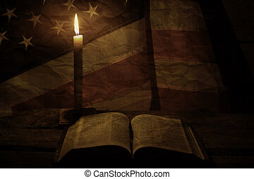 Old USA flag near candle.
