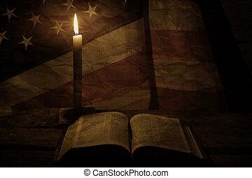 Old USA flag near candle.
