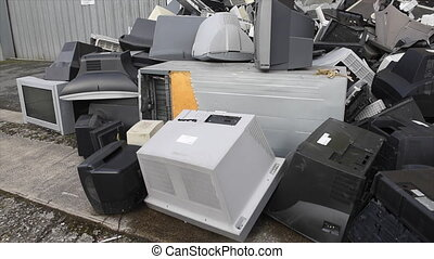 Old used and obsolete electronic equipment before a building