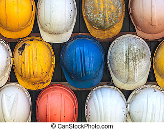 Old used construction helmets - Old and worn colorful...