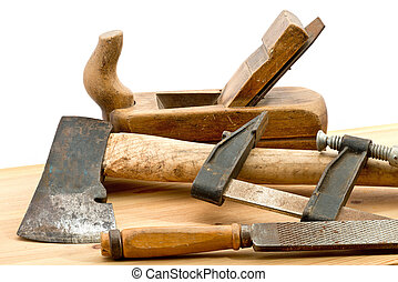 old used tools on the wooden desk