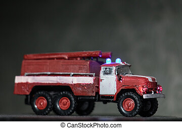 Old USSR fire engine truck. Emergency trucks on duty. ZIS-5 truck in front of PMZ-1 (ZIS-11) machine. Emergency trucks on duty.