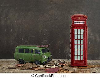 Old van and vintage red phone booth
