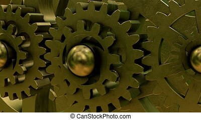 Old various rotating gears in bronze color close up