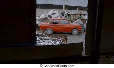 Old Vehicle in Junkyard Awaits For Recycling Metal. Metal...