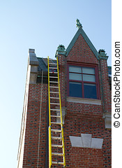Old Victorian Building - A yellow ladder is propped up...