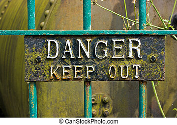 Metal Danger Keep Out Sign On Iron Bars.
