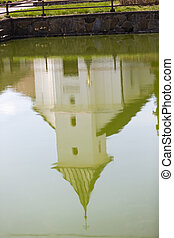 old village christian chapel or church in czech republic - mirror in green water