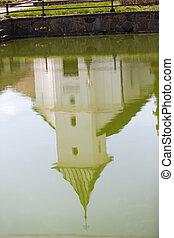 old village christian chapel or church in czech republic - mirror in green water