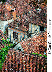 Old village detail of houses with brick roofs and windows