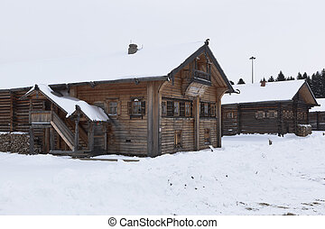 Old village houses in the Museum of Wooden Architecture in the village of Semenkovo, Vologda region