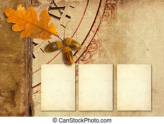 Old vintage album with autumn oak leaves