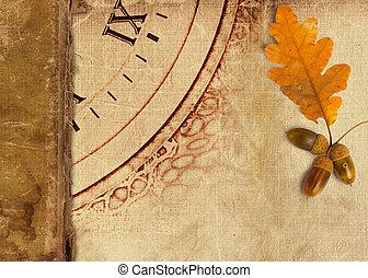 Old vintage album with autumn oak leaves