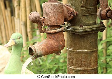 Old vintage antique water pump