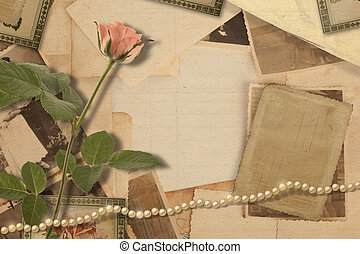 Old vintage archive with photos and pink roses