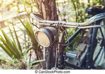 old vintage bicycle and light in garden