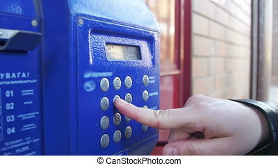 Old, Vintage Blue Telephone with Number Buttons in the Phone Booth