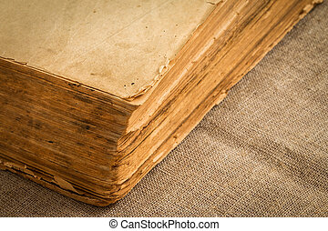 Old vintage book with yellowed aged pages, closeup
