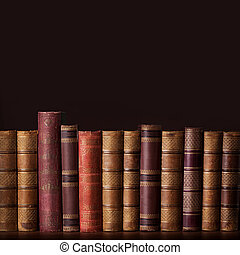 Old vintage books standing in a row