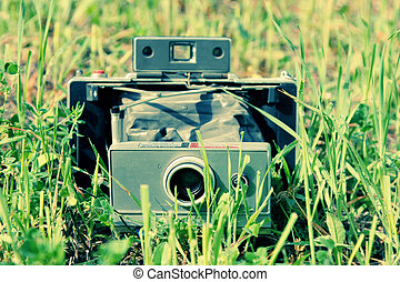 old vintage camera in the field