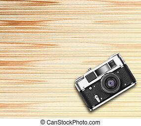 Old vintage camera on wooden background
