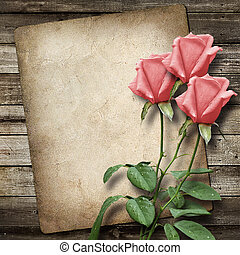 Old vintage card and a bouquet of pink roses