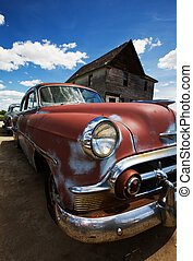 vintage cars - Old vintage cars left to rust in a ghost town