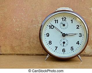 Old vintage clock on wooden background
