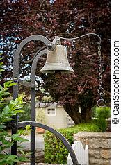 Old vintage doorbell at a garden entrance