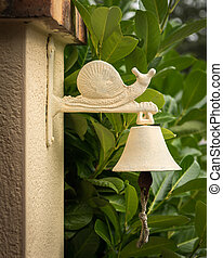 Old vintage doorbell with figure of a snail on top